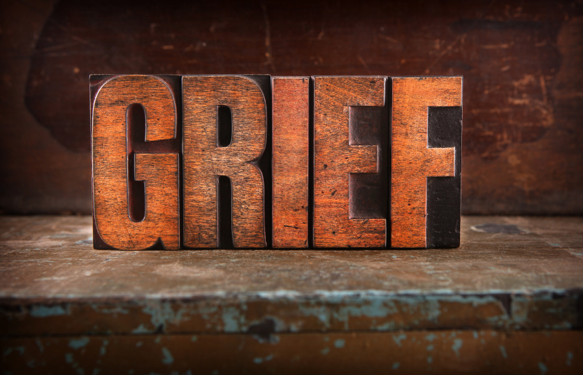 The word Grief in big red letters