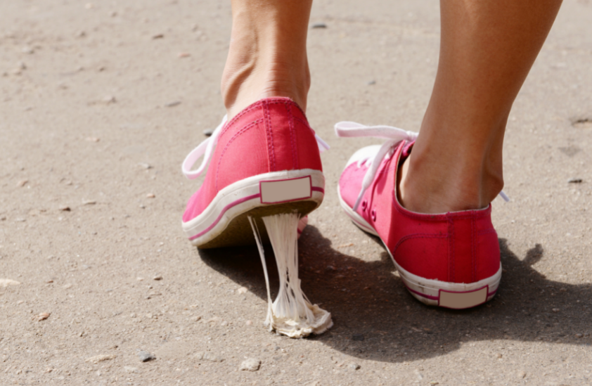 Gum stuck to pink sneakers.