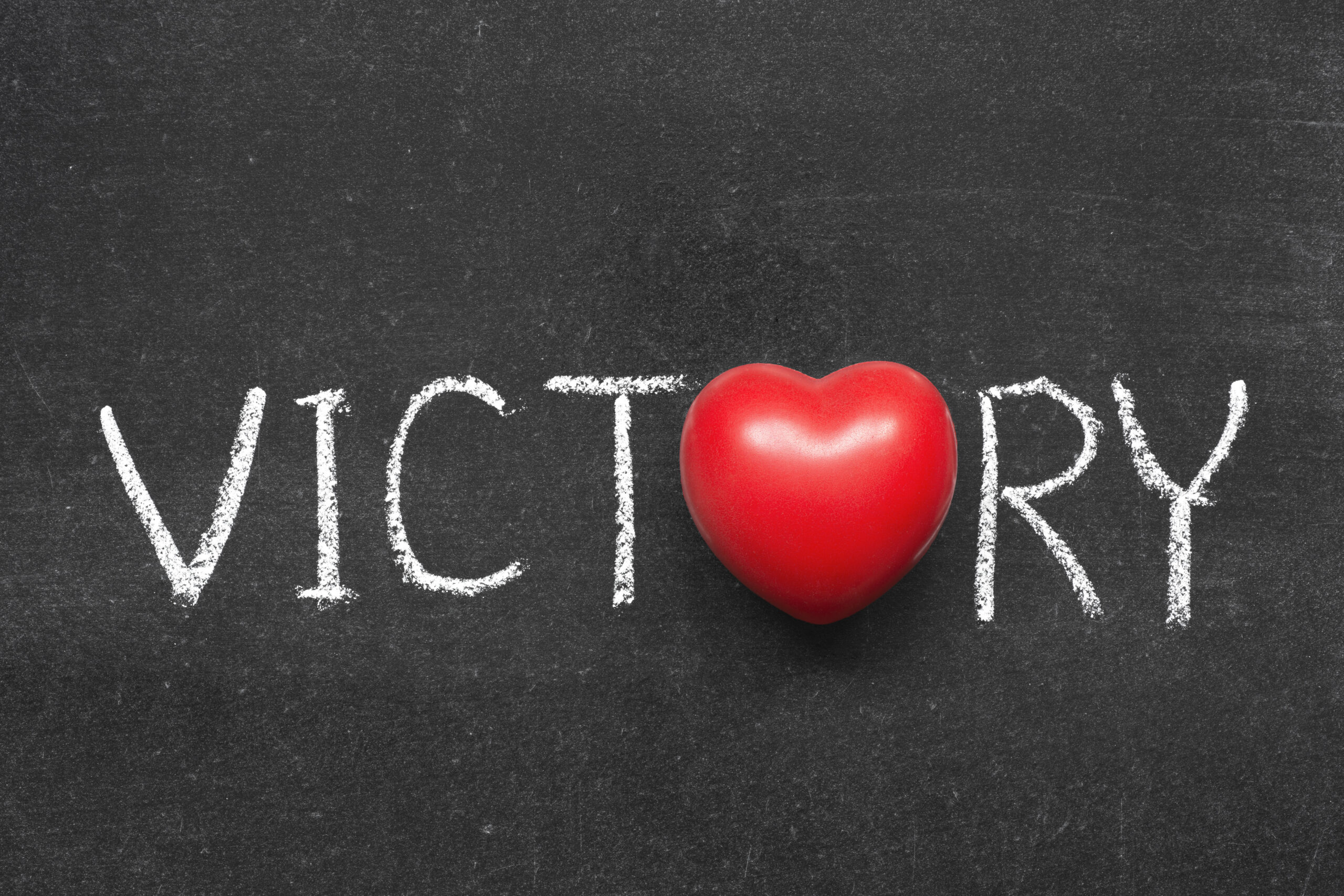 The word victory with a heart as the O