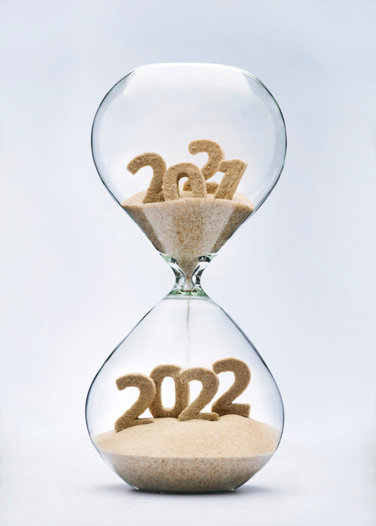 Image of hourglass with 2021 in sand turning into 2022