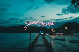 Sweet Escape in neon lights.